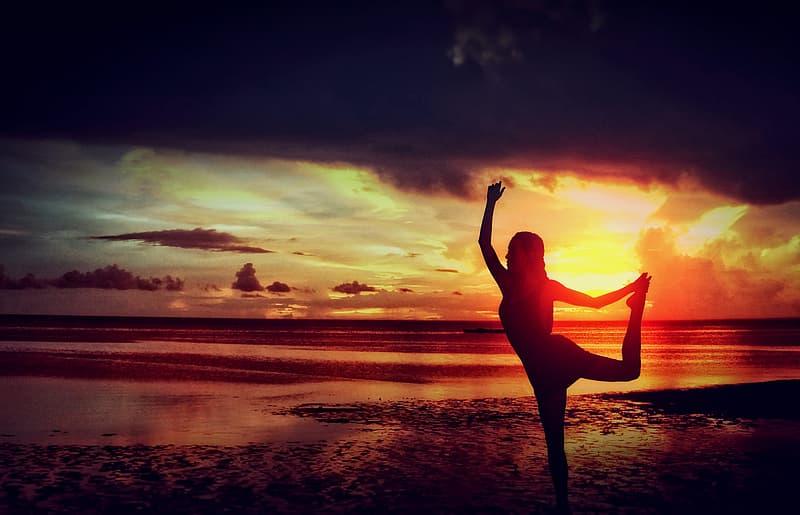 Woman Practising Yoga at the Beach