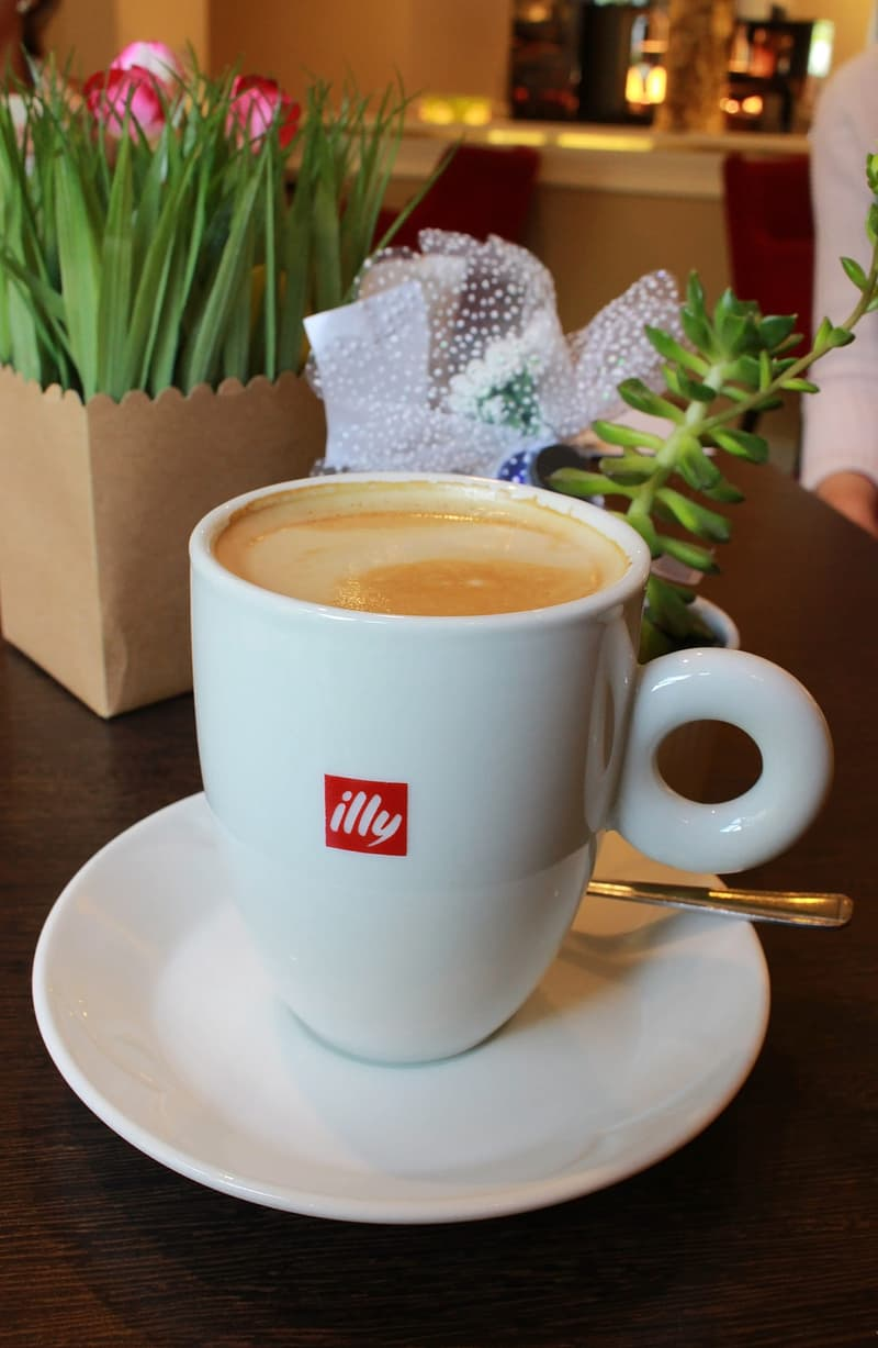 Cup of Illy branded coffee - Illycaffe is an Italian coffee roasting company specializing in espresso - Editorial Use Only