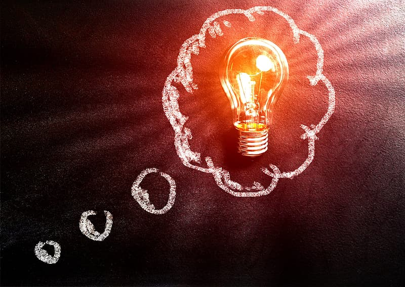 Thought Concept with Light Bulb Over Blackboard