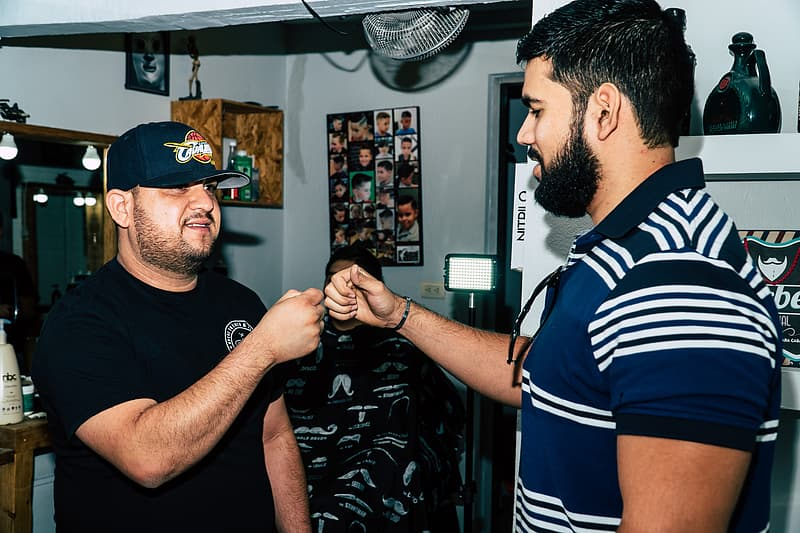 Two Bearded Man Giving Each Other Fist Bump