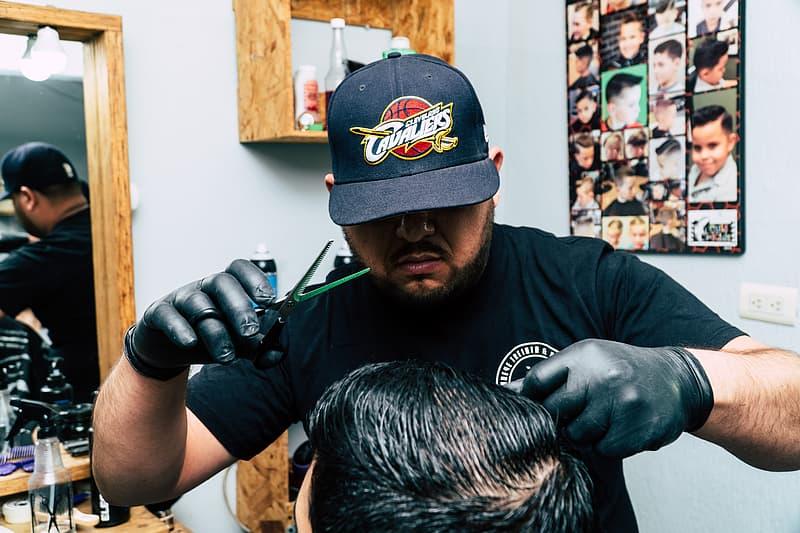 Man Wearing Black Shirt, Cap and Gloves