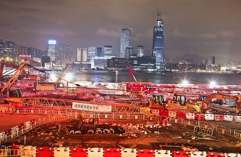 Night View Of Under Construction Building Site With Cranes In Hong Kong